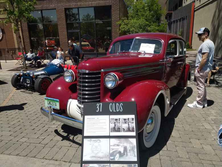 A red 1937 Olds.