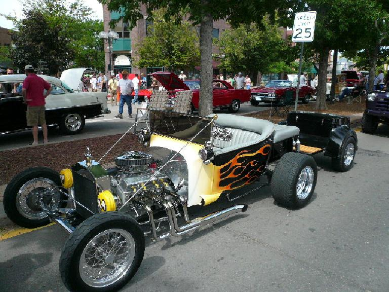 Ford hot rod with flames.