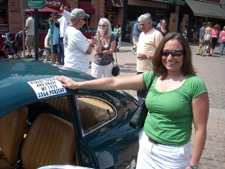 """Please touch and enjoy my 1959 356A Porsche.""  Raquel was happy to oblige."