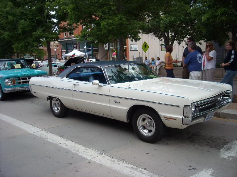 A Plymouth Fury.  Raquel's dad has one of these but a later model.