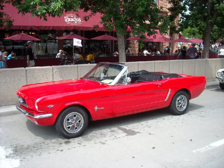 A super red '66 Mustang convertible.