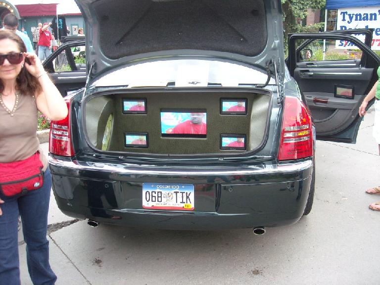 A Chrysler 300C with numerous flat-panel TVs inside the car and in the trunk.