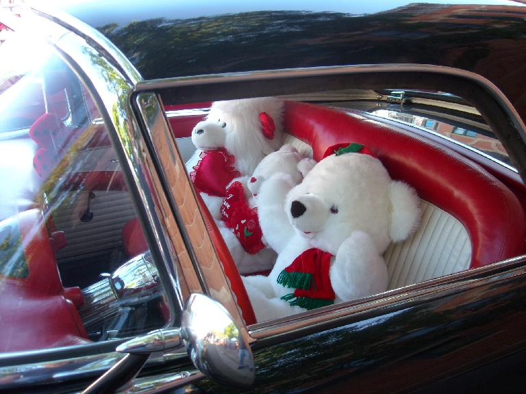 A family of bears in a 50s Ford Thunderbird.