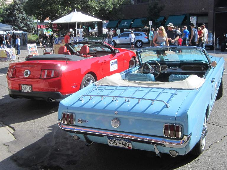 """A red 2011 Ford Mustang with a Columbine blue """"High Country Special"""" first-generation Mustang convertible."""