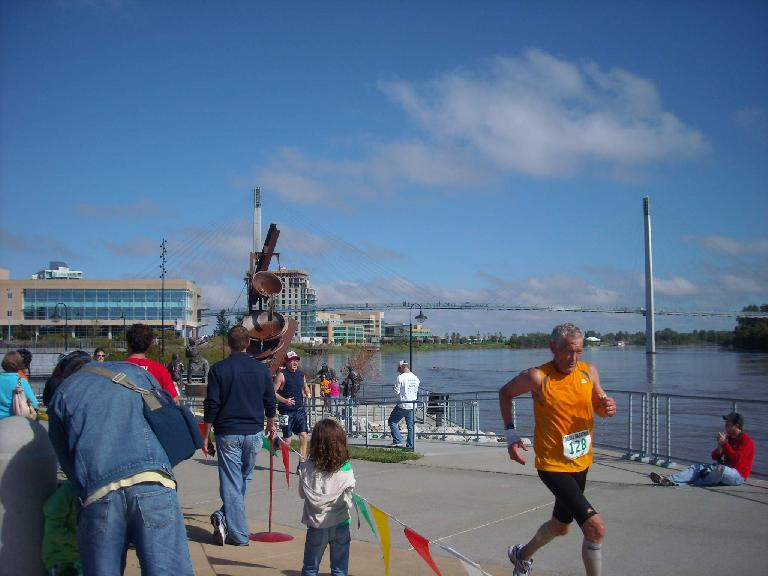 Runners in the final stretch of the Omaha Marathon by the waterfront.