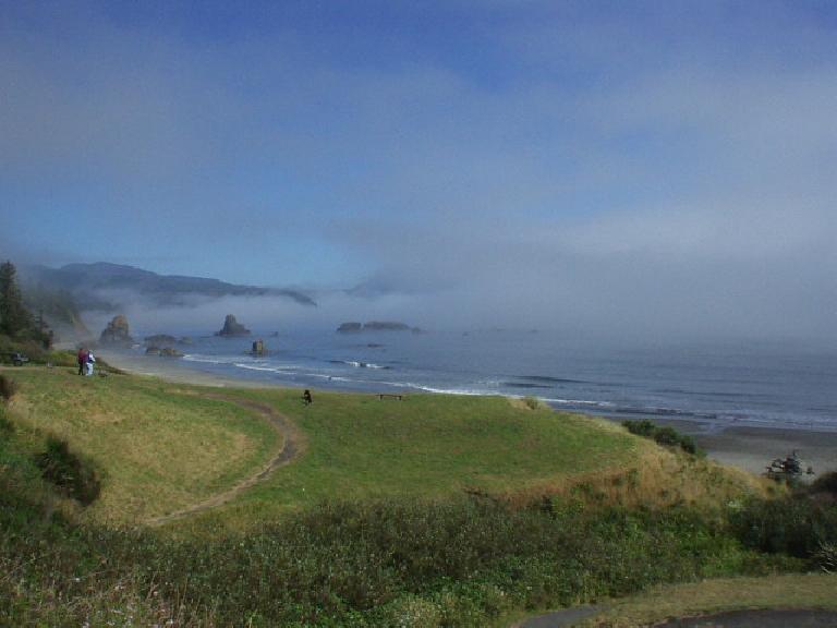 [Battle Rock Wayfinding Point, Port Orford, OR] A beautiful mist overruns a rock coastline while waves crash along the shore.