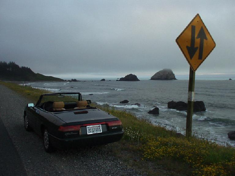 [Bookings, OR] A dimming sunset over a rocky coast is a sight to behold in a fetchin' Italian roadster.