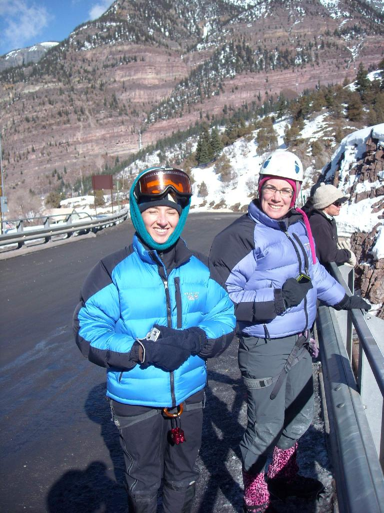 Tori and Michele taking photos of climbers in the Uncompahgre Gorge on a bridge. (February 1, 2009)