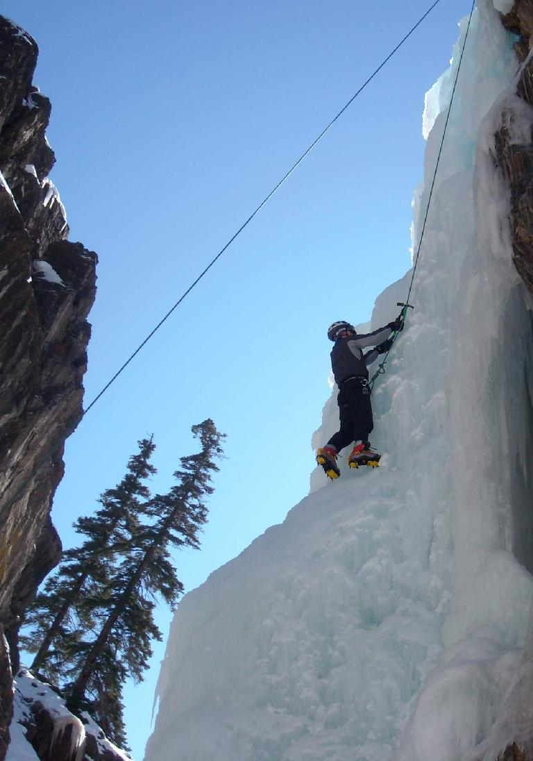 Felix Wong hacking away at a climb in New Frontier.