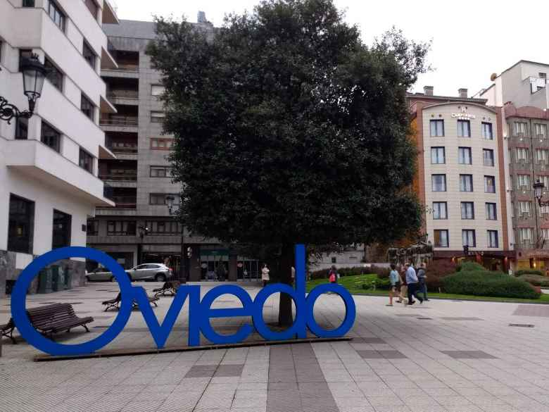 Blue Oviedo sign at Plaza Carbayón in central Oviedo.
