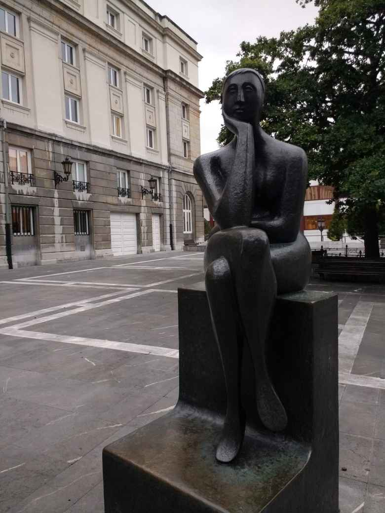 """The Thinker"" (La Pensadora) sculpture, located near a theater in central Oviedo."