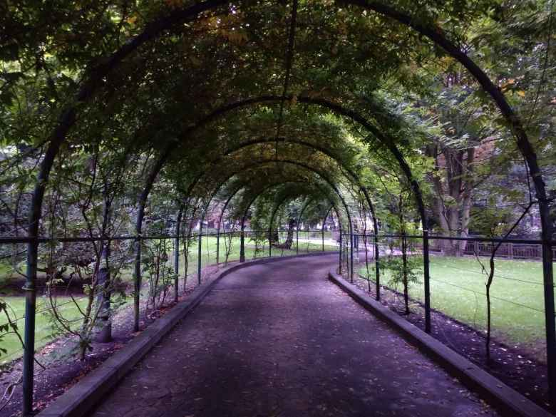Arched walkway through the Campo de San Franciso in central Oviedo.