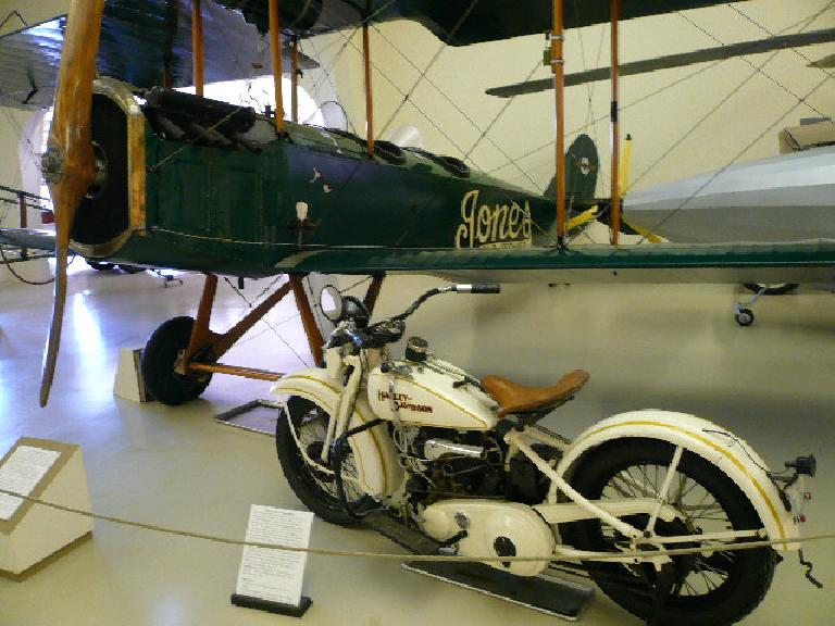 A 1932 Harley Davidson Model V with a 28-hp twin-V and three-speed chain drive, and a plane owned by the Harry Jones Flying Service that gave paid biplane rides in New England.