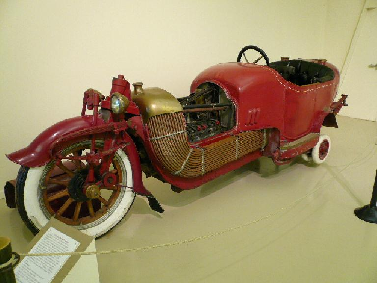 The 1913 Scripps Booth Bi-Autogo seated three, was powered by Detroit's first V-8 engine, and was an exclusive sports car.  Two pairs of landing wheels were used to maintain balance when traveling