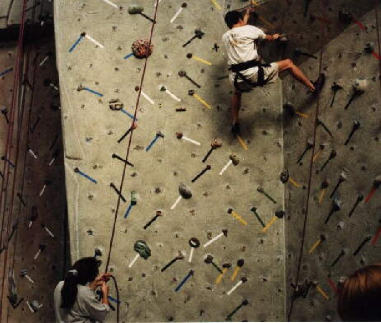 That's Loren C. doing an impressive move on the overhang, with Adrienne belaying.