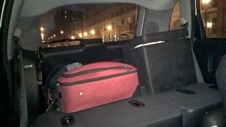 suitcase, ottomans, seats folded down, inside PT Cruiser