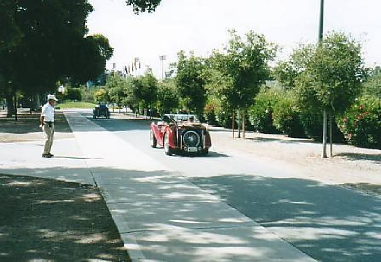 A pre-war MG Midget driving through Stanford.
