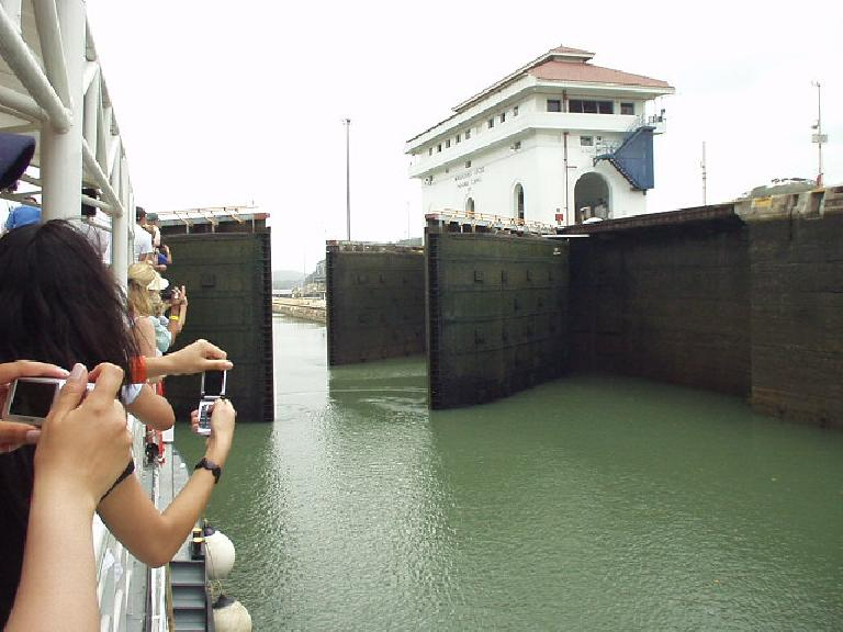 Now that the water level between the second and third locks are level, the gates open.