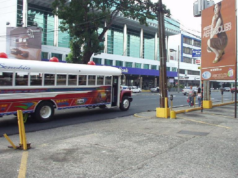 """City buses (probably from the 1970s) at first look pretty ghetto, but I'm sure the city prefers to call them """"rolling art pieces."""""""
