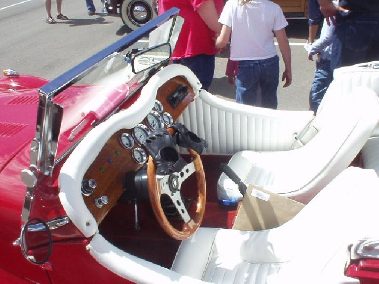 Leather driving gloves and wood steering wheel.  Nice.