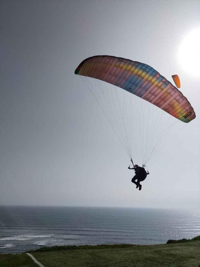 Matthew launching his paraglider in Lima, Peru.