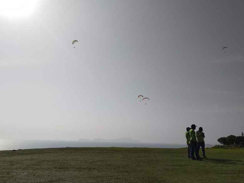 The sun shining brightly on the paragliders of Lima, Peru.