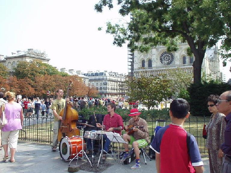 There was a cheery band playing on the sidewalk right in front of the Notre Dame. (August 17, 2003)