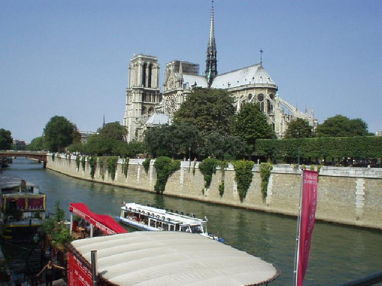 View of Notre Dame from the pedestrian bridge just east of it.  It took 2 centuries to build the Notre Dame, starting in 1163.. (August 17, 2003)