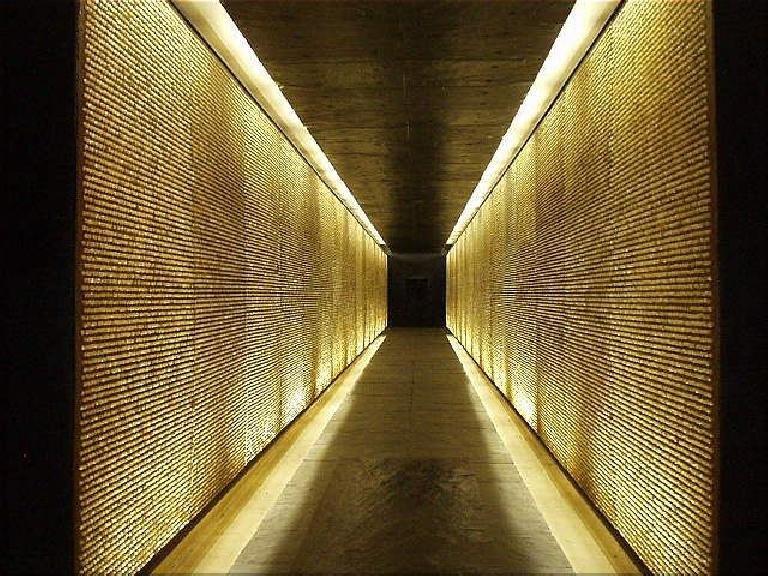 There are 200,000 lighted crystals inside the memorial representing the 200,000 French people who died in the camps.  The feeling of claustrophobia here is intentional and symbolic. (August 17, 2003)