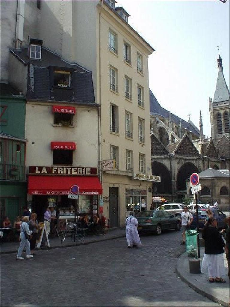 View of La Friterie (no significance other than it's French) from the church of St. Julien-le-Pauvre.  Here the concentration of cafes seem to increase. (August 17, 2003)