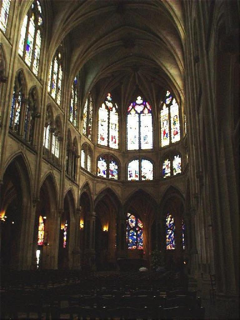 I spent half an hour of peace and solitude inside the church of St. Severin, which (with its exquisite glass work) took a century longer than the Notre Dame to build! (August 17, 2003)