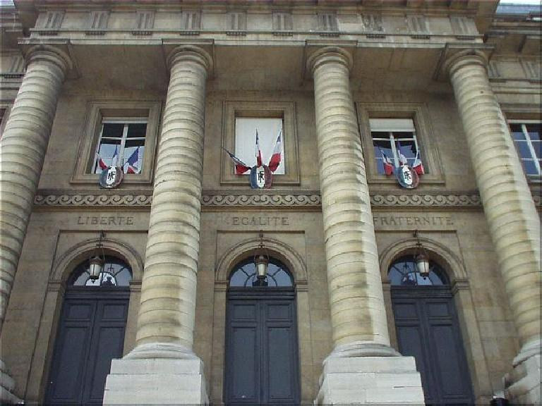 "On the Palais de Justice are the inspiring words ""Liberte, Egalite, Paternite"" (freedom, equality, and brotherhood) which are found in other places in Paris. (August 17, 2003)"