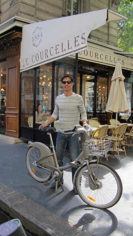 Felix Wong with a city bike. (August 8, 2013)
