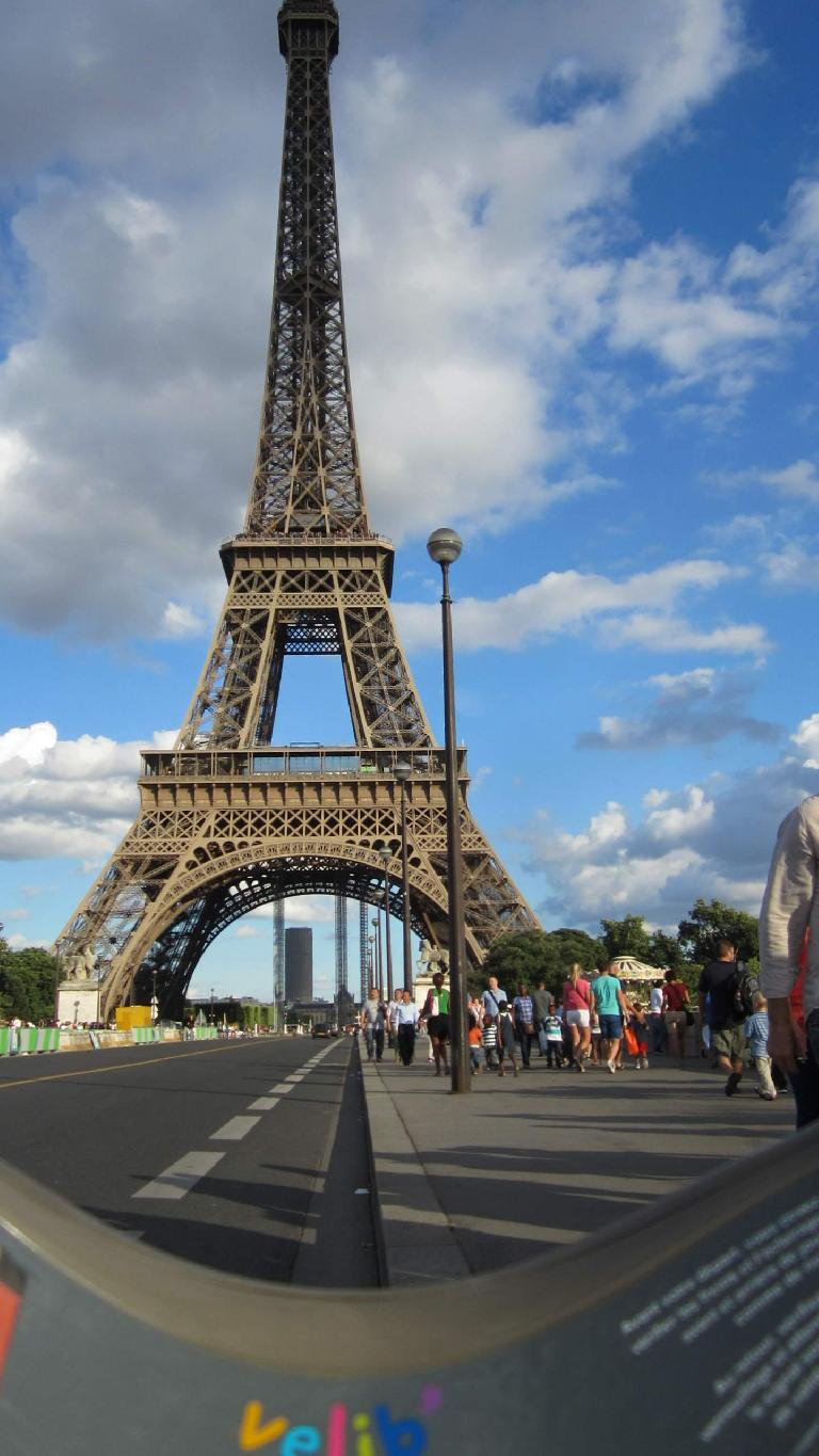 Riding under the Eiffel Tower on a Velib' bicycle. (August 9, 2013)