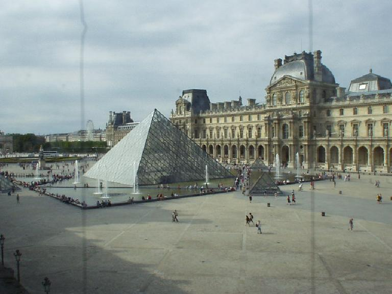 [Louvre] The modern glass pyramid looks pretty cool but a little out of place, in my opinion... (August 15, 2003)