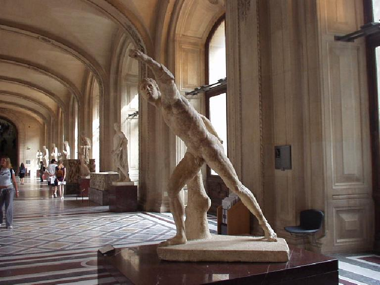 [Louvre] Is this the coolest statue or what?  It's the Guerrier Combattant, dit Gladiateur Borghese (Borghese Gladiator), made around 325 B.C.. (August 15, 2003)
