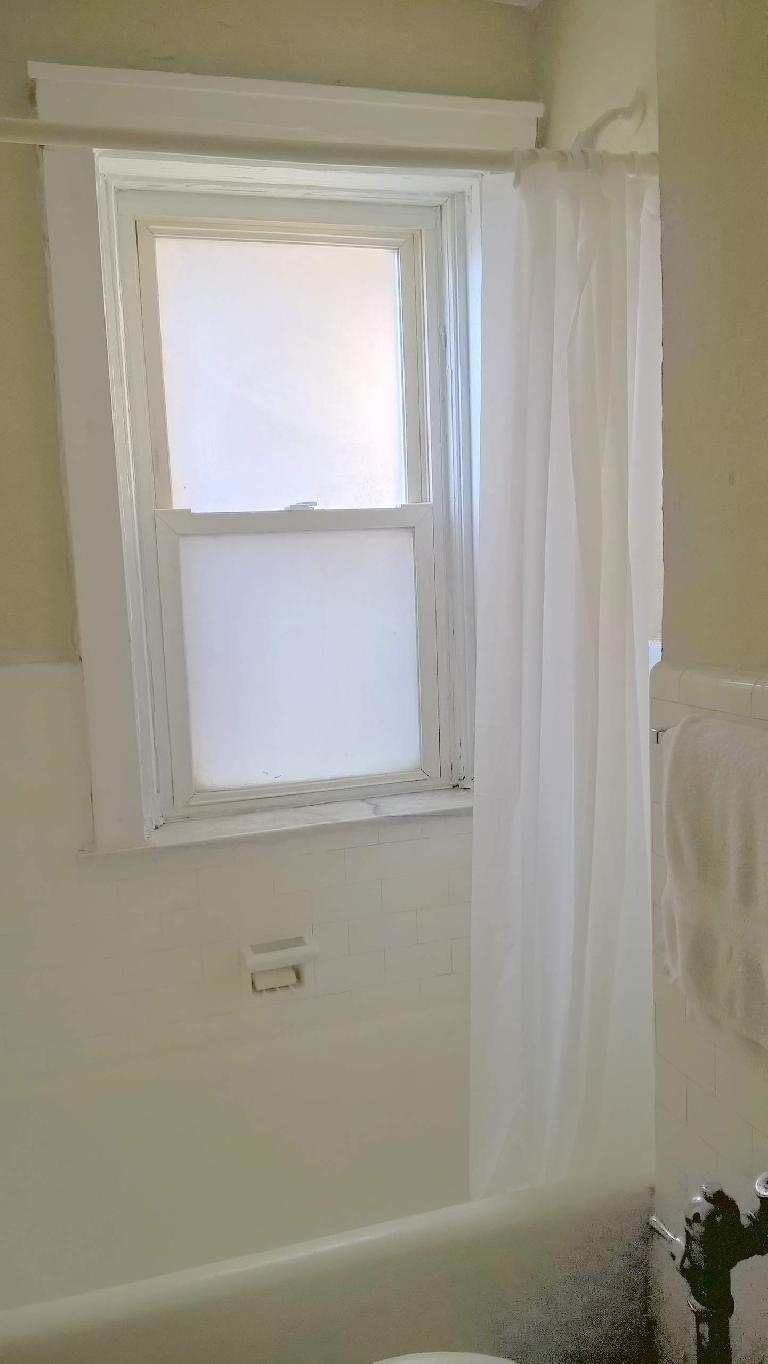 minimalist bathroom, white shower curtain, white towel