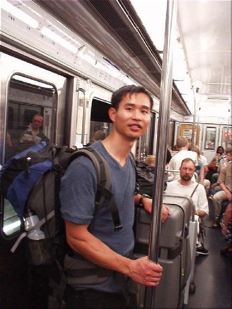 [4 days before the race] Felix Wong on the Metro.  Unfortunately, the RER train (Line C) I was counting on to get me to my hotel was closed for construction, so I ended up walking a mile further than I intended to, lugging my heavy bike case around. (August 14, 2003)