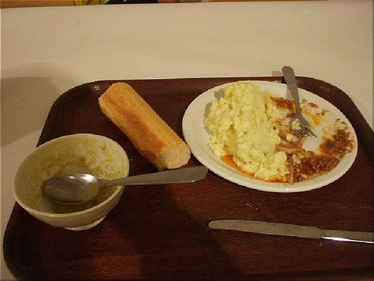 [KM 141, 7:37 elapsed, 5:37am] At least the food was good at the first control.  I ate a bowl of soup, packed the bread, and could only eat half of the huge plate of mashed potatoes. (August 19, 2003)