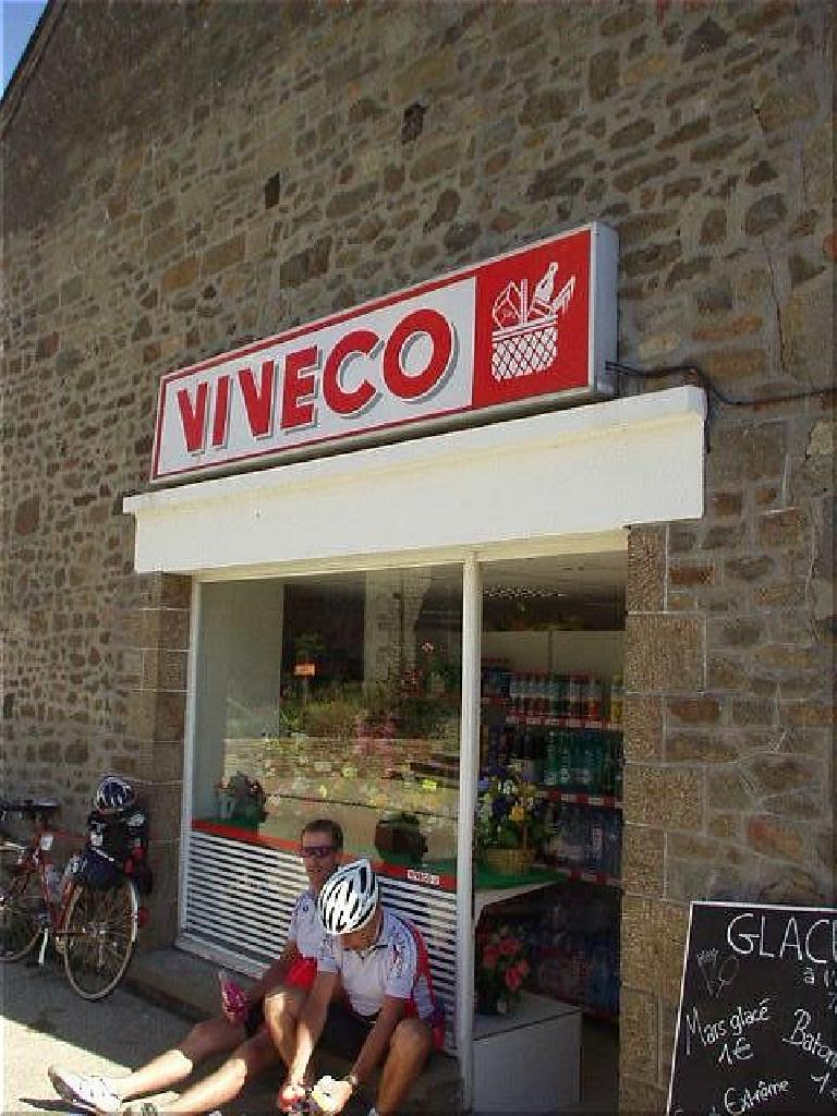 "[KM ~352, 18:55 elapsed, 4:55pm] At Viveco, another supermarche in a small village (I think the village Feins), I purchased some awesome pain d'epices (""bread of spice""), which tasted like cake, for just 1 Euro! (August 19, 2003)"