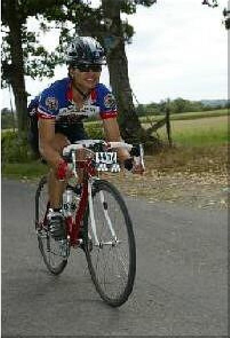 [unknown distance & time] Felix Wong on the road, feeling great at this point! Photo: maindruphoto.com. (August 19, 2003)