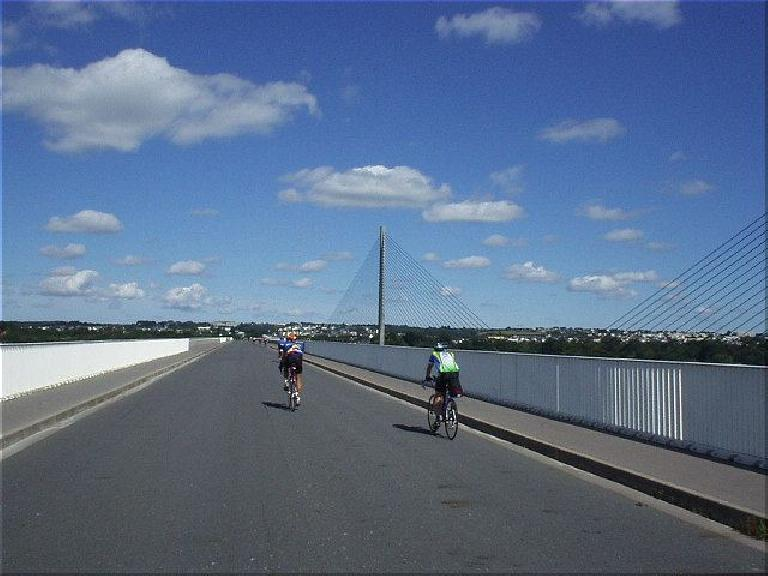 [KM 607, 38:16 elapsed, 12:16pm] Made it to the coast; almost to Brest!  This is a nice bridge, but I'd be less impressed with Brest itself, which has typical big city problems (but is not nearly as beautiful as Paris). (August 20, 2003)