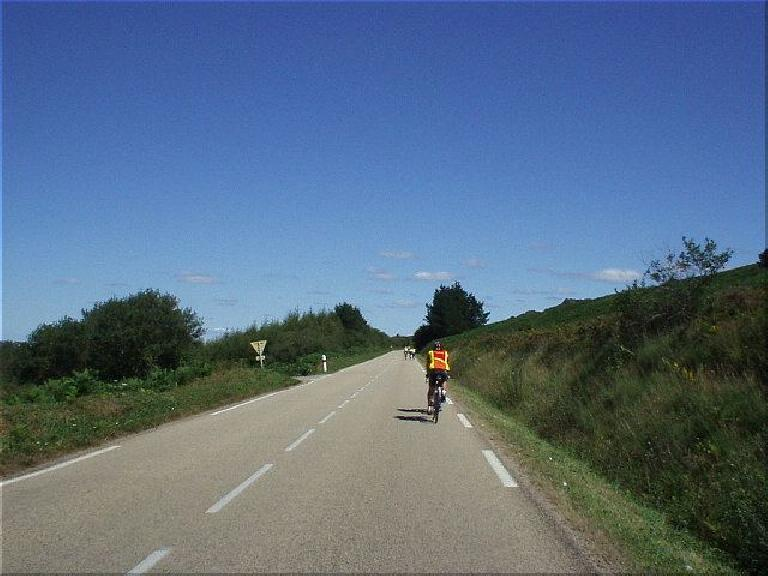 [KM ~667, 41:26 elapsed, 3:26pm] Coming back from Brest presented the longest climb of the day: about 30 minutes to ascend, I think.  Being powered my a mere bagette, I'd bonk shortly thereafter, facing my first food crises of the race. (August 20, 2003)