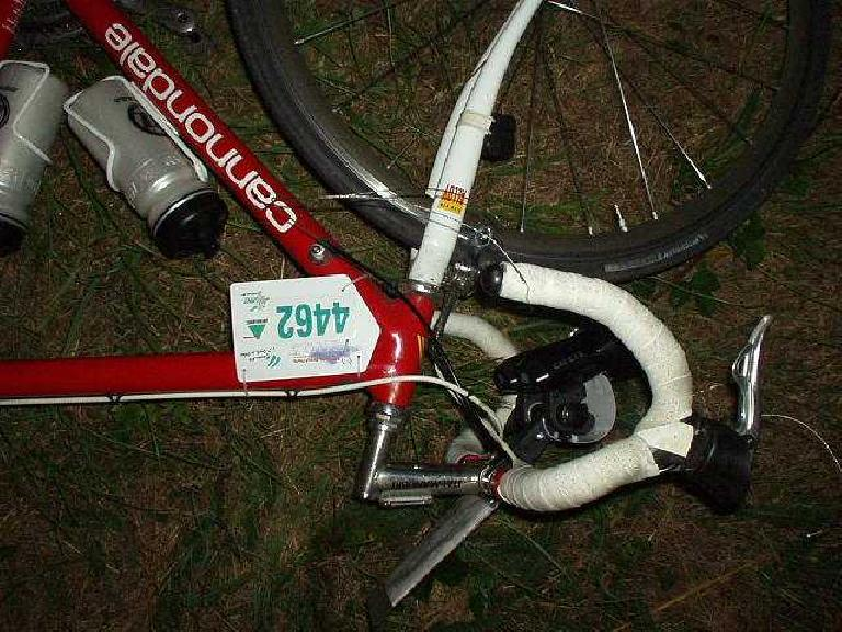 "[KM ~790,  49:22 elapsed, 11:22pm] Mechanical problem!  Front derailleur cable broke.  Fortunately I had a spare, but since I opted not to bring cable cutters, I had to make do with a dull ""Swiss Army-type"" knife to cut it. (August 20, 2003)"