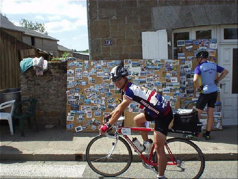[KM ~937, 62:34 elapsed, 12:34pm] Some guys had opened up their garage which had proudly displayed a ton of postcards from grateful PBP riders.  I did stop here... (August 21, 2003)