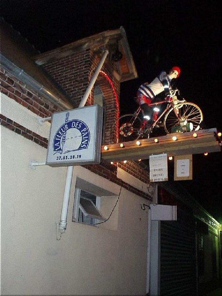 [KM ~1155, 73:29 elapsed, 1:29am] Almost to the Nogent controle in the middle of the night and all alone, I pass through a town where there obviously were quite a few cycling (and PBP) enthusiasts. (August 22, 2003)