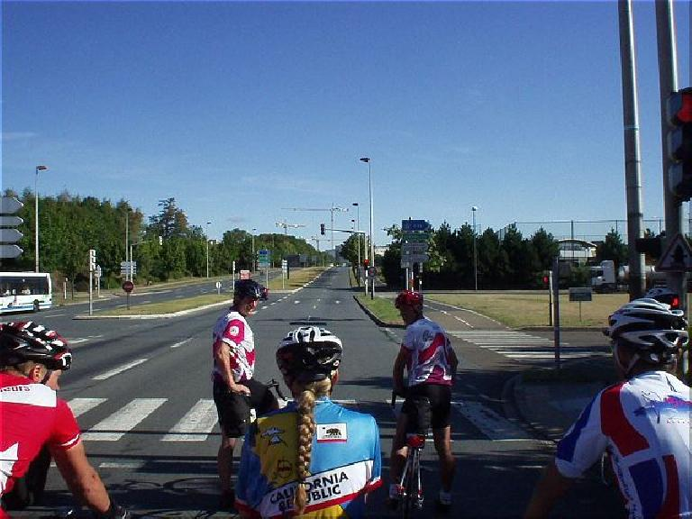 [KM 1223, 84:29 elapsed, 10:29am] Back in Guyancourt, with a group including a Californian rider I thought I recognized from the Davis brevets. (August 22, 2003)