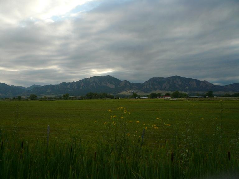 [Mile 182, 6:48 p.m.] The Flatirons west of Boulder were now in sight as we approached Louisville.