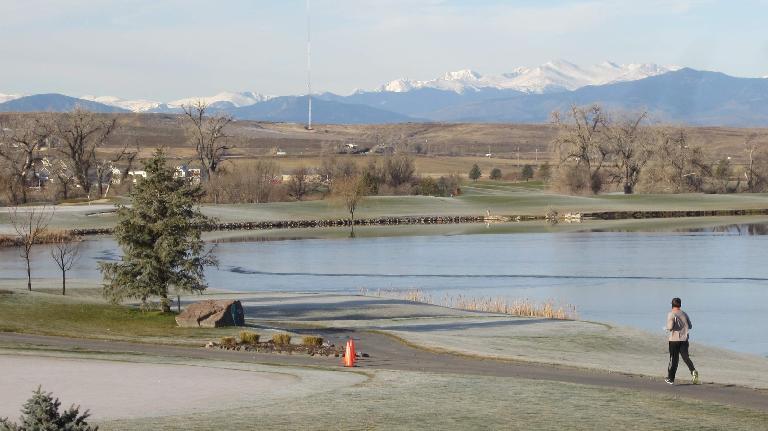 A runner enjoys the astounding views of the Pelican Lakes Turkey Trot 5k.