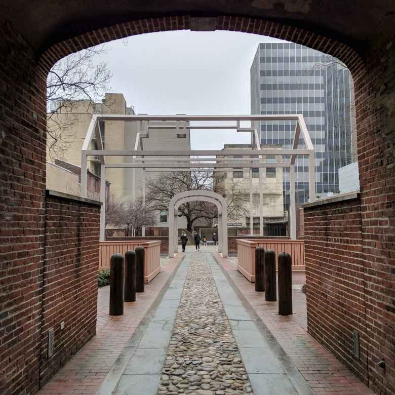 "This passageway led to Ben Franklin's home, which is depicted by the ""ghost arches."""